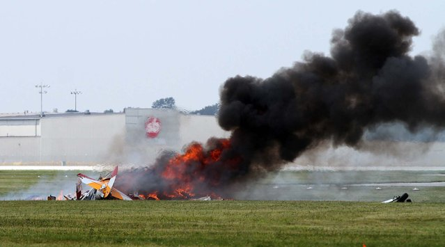 The plane burns after the crash. (Photo by Darin Pope/Dayton Daily News)