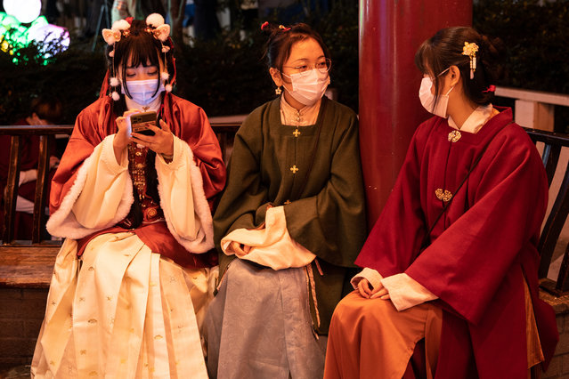 Women wearing traditional outfits chat during subdued Lunar New Year celebrations on February 12, 2021 in Yokohama, Japan. Yokohama's Chinatown, the largest in Japan, has imposed restrictions on celebrations marking Lunar New Year as the country continues to grapple with the Covid-19 coronavirus pandemic which has so far accounted for 6,800 deaths from 412,124 recorded infections. (Photo by Takashi Aoyama/Getty Images)