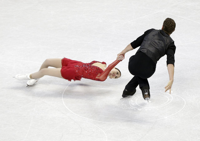 Haven Denney, left, and Brandon Frazier skate during the pairs short program at the U.S. Figure Skating Championships in Greensboro, N.C., Thursday, January 22, 2015. (Photo by Chuck Burton/AP Photo)