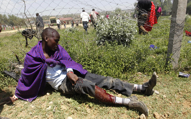 A resident is seen shot and injured during protests to oust the Narok county Governor Samuel Tunai in Narok, Kenya, January 26, 2015. (Photo by Thomas Mukoya/Reuters)