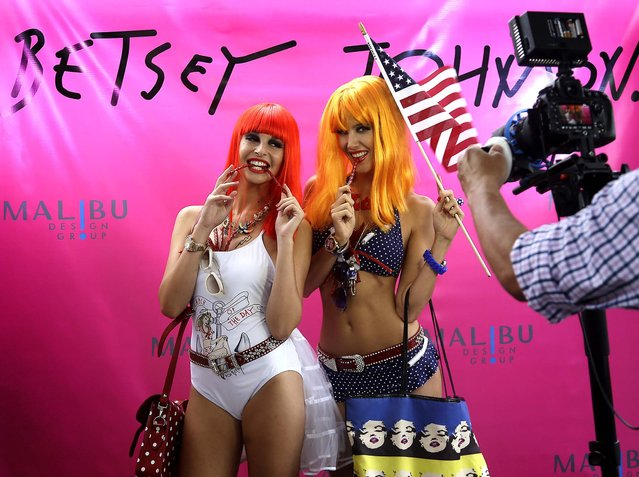 Models pose during a Betsey Johnson swimwear show. (Photo by Lynne Sladky/Associated Press)