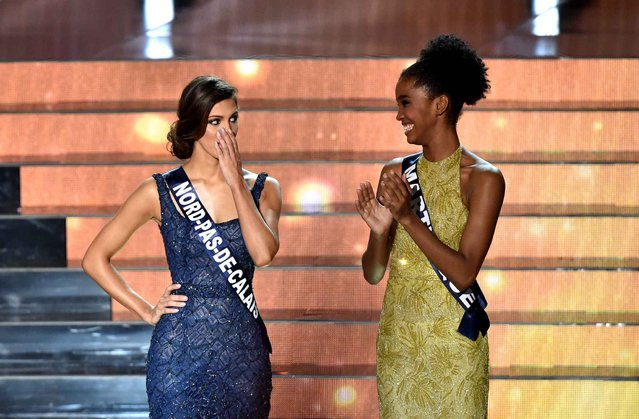 Miss Nord Pas de Calais Iris Mittenaere (L) is selected Miss France 2016 by Miss France 2015 Camille Cerf during the Miss France 2016 beauty contest on December 19, 2015 in Lille. (Photo by Philippe Huguen/AFP Photo)