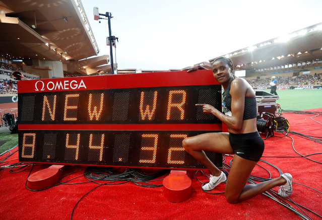 """Kenya' s Beatrice Chepkoech celebrates after her new world record in the women' s 3000 metre steeplechase at the IAAF Diamond League athletics """"Herculis"""" meeting at The Stade Louis II Stadium in Monaco on July 20, 2018. Kenyan Beatrice Chepkoech ran 8min 44.32 sec to set a new 3000 m steeplechase world record at the Diamond League meet in Monaco. (Photo by Eric Gaillard/Reuters)"""