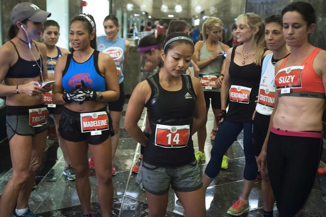 Members of the Women's Elite class stand near the starting line before the start of the 38th Annual Empire State Building Run-Up in the Manhattan borough of New York February 4, 2015. (Photo by Carlo Allegri/Reuters)