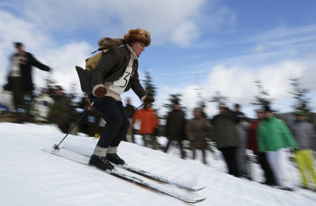 "A participant competes in the ""Nostalgic Ski Race"" in the western town of Neuastenberg February 8, 2015. (Photo by Ina Fassbender/Reuters)"
