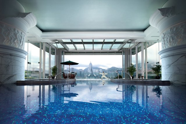 World's Greatest Swimming Pools: The Peninsula, Hong Kong. First off, bask in the Roman-inspired design (marble columns, friezes, statues, you get the idea). But this tranquil natatorium also beguiles with floor-to-ceiling windows and glass doors, which open up to an adjacent sun terrace. There, enjoy a bite to eat and more of that superb skyline as you dry off. (From $558). (Photo by The Peninsula)