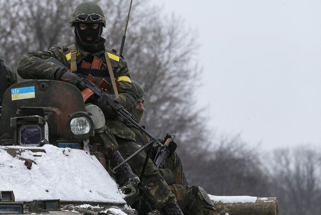 Members of the Ukrainian armed forces ride on an armoured personnel carrier (APC) near Debaltseve, eastern Ukraine, February 10, 2015. (Photo by Gleb Garanich/Reuters)