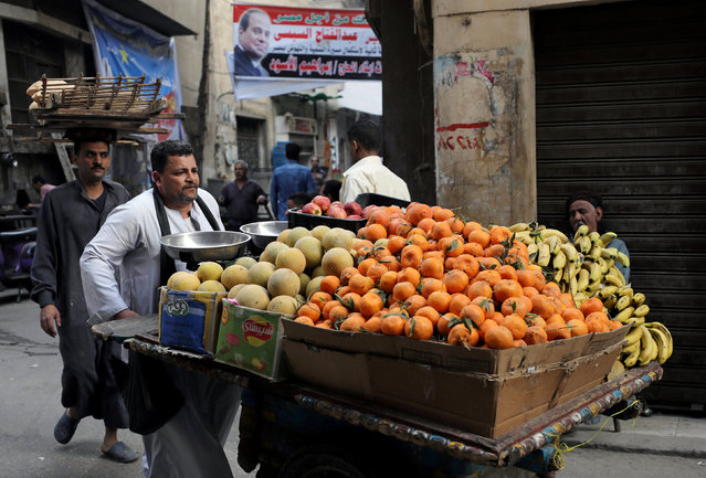 An Egyptian fruit seller is seen at a market in Cairo, Egypt March 19, 2018. (Photo by Mohamed Abd El Ghany/Reuters)