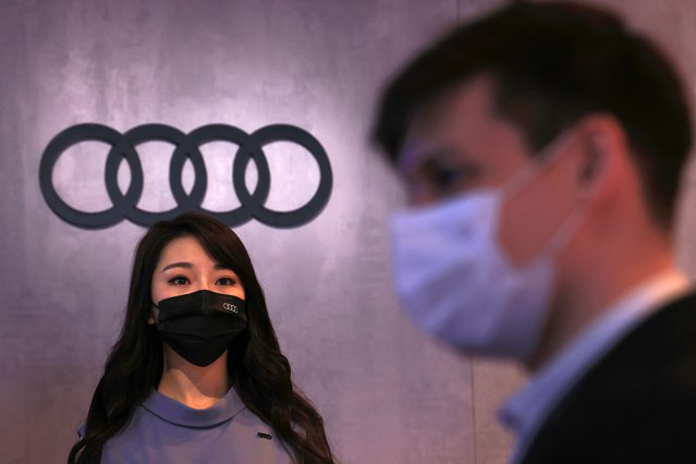 A worker prepares for press day at the Audi booth during Shanghai Auto Show in Shanghai on Monday, April 19, 2021. (Photo by Ng Han Guan/AP Photo)