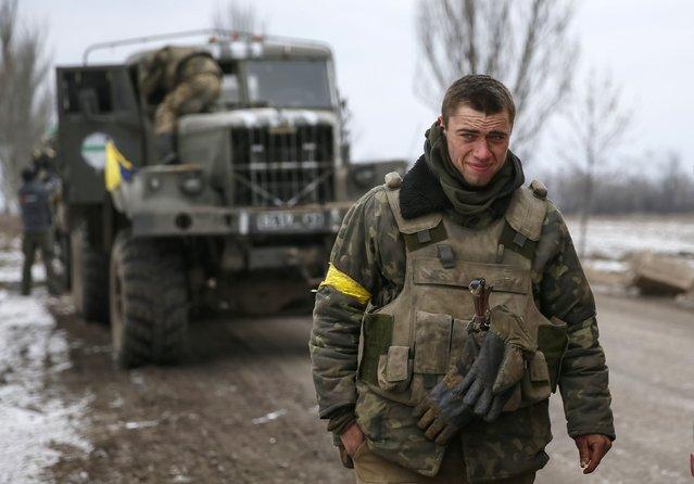 A Ukrainian serviceman who fought in Debaltseve is seen near Artemivsk February 19, 2015. (Photo by Gleb Garanich/Reuters)