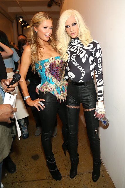 Paris Hilton (L) and designer Phillipe Blond pose for a photo backstage at The Blonds fashion show during Mercedes-Benz Fashion Week Fall 2015 at Milk Studios on February 18, 2015 in New York City. (Photo by Monica Schipper/Getty Images)