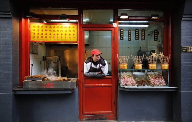 A food vendor waits for customers at a shopping district in Beijing February 10, 2015. (Photo by Kim Kyung-Hoon/Reuters)
