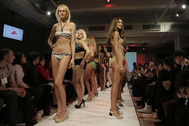 "Models pose on the runway during the fianle of the 2015 CURVExpo and Invista sleepwear, loungewear and swim collections, during the 2nd annual Lingerie Fashion Night, ""Romancing the Runway"", in New York, Monday, February 23, 2015. (Photo by Richard Drew/AP Photo)"