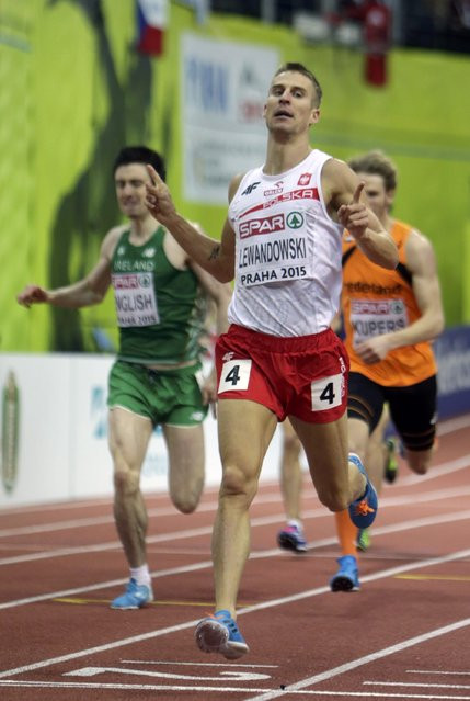 Marcin Lewandowski of Poland wins the men's 800 metres final in front of Mark English of Ireland (L) and Thijmen Kupers of Netherlands (R) during the European Indoor Championships in Prague March 8, 2015. REUTERS/David W Cerny (CZECH REPUBLIC  - Tags: SPORT ATHLETICS)