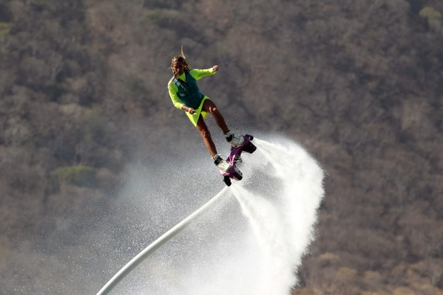 A woman practices flyboarding at the Xiloa Lagoon in Managua March 15, 2015. A team of young Mexicans are conducting demonstrations of the extreme sport flyboarding in different beaches in Nicaragua. (Photo by Oswaldo Rivas/Reuters)