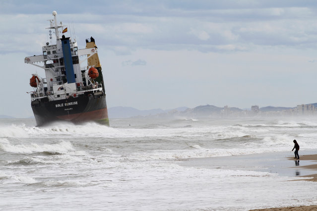 The cargo ship BSLE Sunrise lies stranded close to the shore in Valencia after a heavy rainstorm, September 29, 2012. The two cargo ships, Celia and the BSLE Sunrise, which were anchored in front of the Valencia port were stranded by heavy rainstorms. (Photo by Heino Kalis/Reuters)