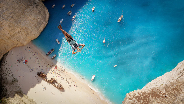 Matt Blank jumping over The beautiful Navagio Beach very relaxed. (Photo by Brian Mosbaugh/Caters News)