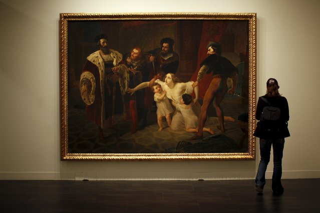 """A woman looks at """"The death of Ines de Castro, morganatic wife of Don Pedro, Infant of Portugal"""" by Russian-born artist Karl Bryullov during an international press tour of the Malaga branch of the State Museum of Russian Art of St Petersburg, a day before its inauguration in Malaga, southern Spain March 24, 2015. (Photo by Jon Nazca/Reuters)"""