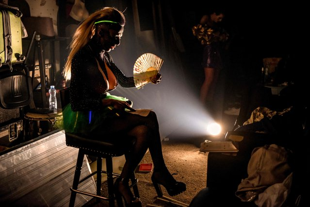 A drag queen performer gets ready before a show at a theater in Pristina, Kosovo on June 29, 2021. (Photo by Armend Nimani/AFP Photo)
