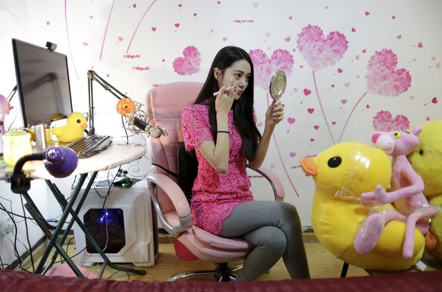 Online hostess Xianggong checks her makeup before she gives a live broadcast in her bedroom in Beijing, February 10, 2015. (Photo by Jason Lee/Reuters)