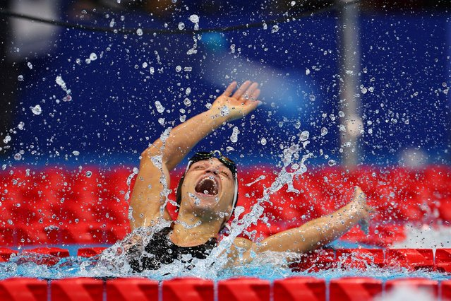 Cyprus' Karolina Pelendritou celebrates after winning the women's 100m breaststroke SB11 swimming final during the Tokyo 2020 Paralympic Games at the Tokyo Aquatics Centre in Tokyo on September 1, 2021. (Photo by Marko Djurica/Reuters)