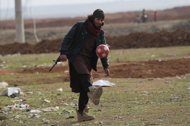 A rebel fighter plays with a ball in al-Rai town, northern Aleppo countryside, Syria January 20, 2017. (Photo by Khalil Ashawi/Reuters)