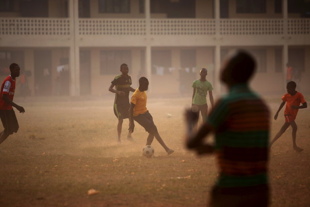 Boys play soccer on a field of a school used as an electoral centre at the end of the presidential and legislative elections, in the mostly muslim PK5 neighbourhood of Bangui, Central African Republic, February 14, 2016. (Photo by Siegfried Modola/Reuters)