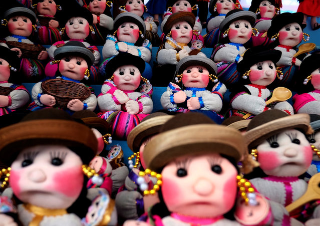 "Aymara dolls are seen during the ""Alasitas"" fair, where people buy miniature versions of goods they hope to acquire in real life, in La Paz, Bolivia, January 24, 2017. Shoppers fill their baskets with miniature versions of things they desire – everything from cars, houses computers – to give to Ekeko the God of abundance, in the hope he will being therm good fortune. And it is all carried out with a priest's blessing. Originally, the Festival of Alasitas was a celebration by farmers praying for plentiful crops.Today, the meaning amounts to the same only locals hope for more material goods. (Photo by David Mercado/Reuters)"