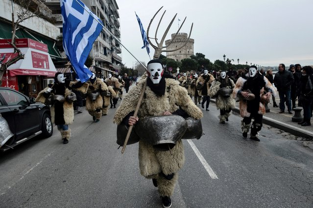 "Members of bell bearer groups from Greece and Europe parade during the 5th edition of the European Bell Bearers Festival on February 24, 2019, in the northern Greek port city of Thessaloniki. The custom of the ""Koudounoforoi"" (bell bearers) is a folklore tradition residue of ancient rituals in honour of the God Dionysos, the Greek god associated with pleasure, festivity, wine and euphoria. They wear hand-made costumes of leather and fur and bells of different sizes. The noise of the bells is believed to be used to frighten the evil spirits and awaken nature to the coming of spring. (Photo by Sakis Mitrolidis/AFP Photo)"
