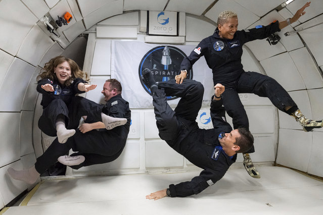 The Inspiration4 crew of Chris Sembroski, Sian Proctor, Jared Isaacman and Hayley Arceneaux float during a zero gravity flight in a modified Boeing 727 plane which flies multiple parabolic arcs to provide 20-30 seconds of weightlessness in Las Vegas, USA on September 12, 2021. (Photo by John Kraus/AP Photo)