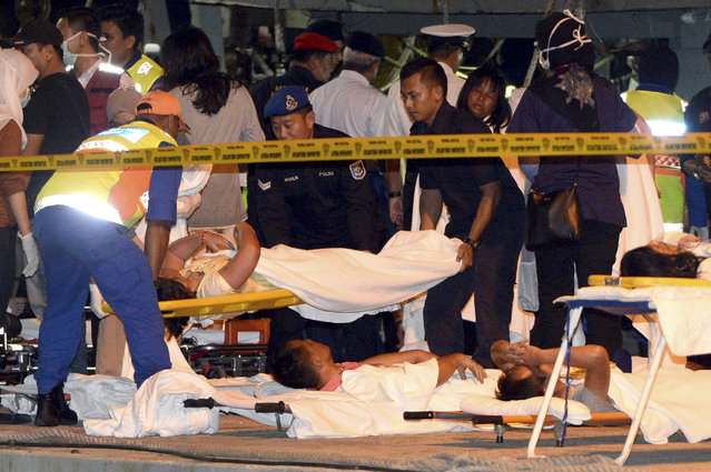 Survivors of a sank boat receive medical assistance at the Malaysia Marine Operation Force post in Kota Kinabalu, Sabah, Malaysia on Monday, January 30, 2017. More than 20 people, mostly Chinese tourists, were rescued Sunday after their boat sank in strong wave. (Photo by AP Photo)