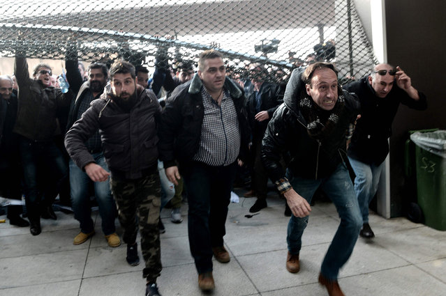Farmers broke a door grid outside an agricultural fair in Thessaloniki, Greece on February 2, 2017, during a protest against government' s measures aiming at increasing their taxes and social insurance contributions. (Photo by Sakis Mitrolidis/AFP Photo)