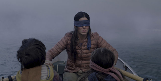 "This file image released by Netflix shows Sandra Bullock in a scene from the film, ""Bird Box"". Netflix lifted the usually tightly sealed lid on its viewership numbers in a recent tweet that disclosed 45 million subscriber accounts had watched the thriller, ""Bird Box,"" during its first seven days on the service. That made the film the biggest first-week success of any movie made so far for Netflix's 12-year-old streaming service. (Photo by Merrick Morton/Netflix via AP Photo)"