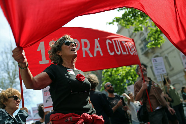 People shout slogans during a march marking the international May Day, in Lisbon, Friday, May 1, 2015. (Photo by Francisco Seco/AP Photo)