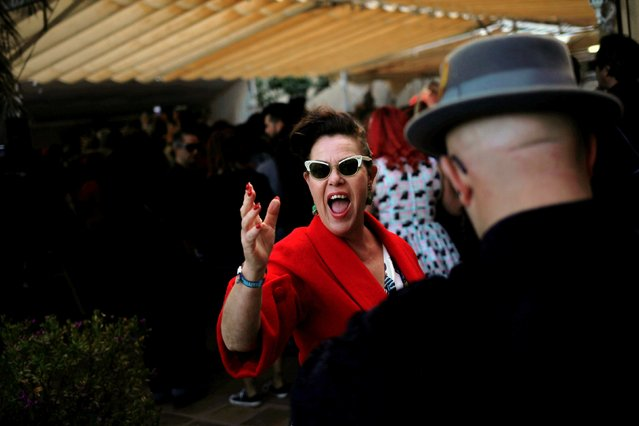 A woman dressed in a fifties-style outfit, gestures as she attends the 23rd Rockin' Race Jamboree International Festival in Torremolinos, near Malaga, southern Spain February 4, 2017. (Photo by Jon Nazca/Reuters)