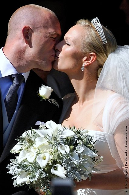 England rugby captain Mike Tindall and Zara Phillips kiss as they leave the church after their marriage