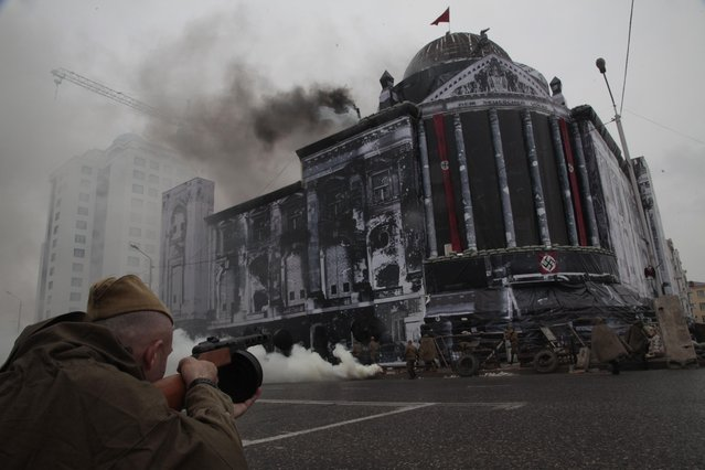 "A theater stage performance ""Seizure of Reichstag"" is shown during celebrations marking the 70th anniversary of the victory over Nazi Germany, in Chechnya's provincial capital Grozny, Russia, Saturday, May 9, 2015. (Photo by Musa Sadulayev/AP Photo)"