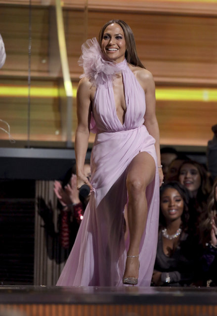 Jennifer Lopez presents the award for best new artist at the 59th annual Grammy Awards on Sunday, February 12, 2017, in Los Angeles. (Photo by Matt Sayles/Invision/AP Photo)