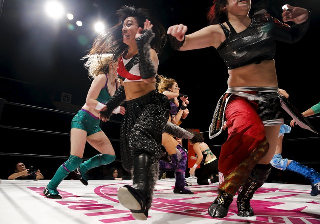 Wrestler Kris Wolf (C) and fellow wrestlers scatter across the ring during their Stardom female professional wrestling show at Shinkiba 1st Ring in Tokyo, Japan, December 6, 2015. (Photo by Thomas Peter/Reuters)