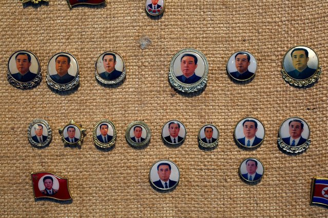 Pins featuring former North Korean leaders Kim Il Sung and Kim Jong Il are displayed in a glass case of Thomas Hui at his apartment in Hong Kong, China April 11, 2016. (Photo by Bobby Yip/Reuters)