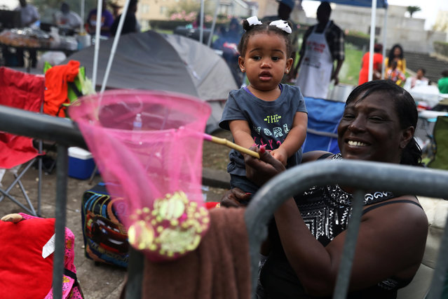 A girl holds out a fishing net full of beads as the Krewe of Zulu parade marches during Mardi Gras in New Orleans, Louisiana U.S., February 28, 2017. (Photo by Shannon Stapleton/Reuters)