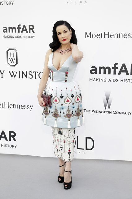 Performer Dita Von Teese poses for photographers upon arrival for the amfAR Cinema Against AIDS benefit at the Hotel du Cap-Eden-Roc, during the 68th Cannes international film festival, Cap d'Antibes, southern France, Thursday, May 21, 2015. (Photo by Thibault Camus/AP Photo)
