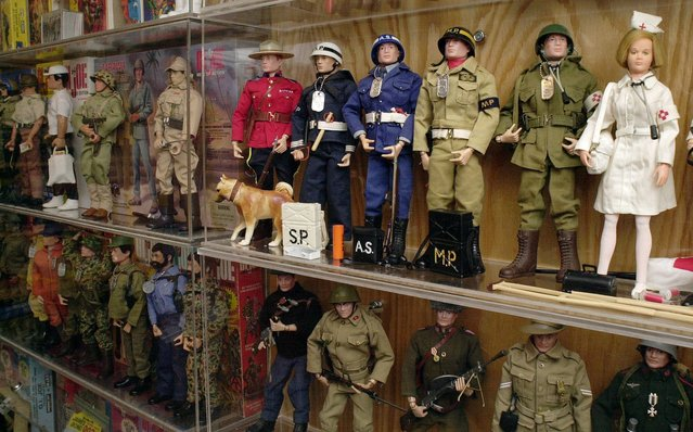 Part of the G.I. Joe action figure collection belonging to Paul Arnold is shown Wednesday, June 26, 2002, at his home in Virginia Beach, Va. Arnold has a collection of more than 160 G.I. Joe figures, including the one  nurse figure, right, and hundreds of accessories from clothing and vehicles to a space capsule and suits. (Photo by Gary C. Knapp/AP Photo)