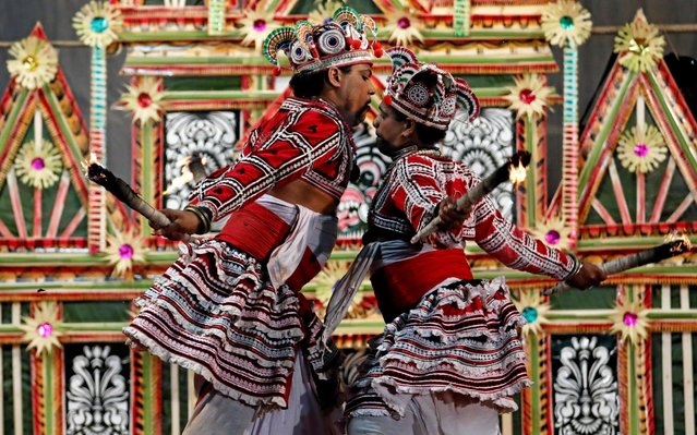 Traditional dancers perform during a healing ritual performance to invoke the blessings of the gods in the village of Hirana, near Colombo, Sri Lanka March 10, 2019. (Photo by Dinuka Liyanawatte/Reuters)