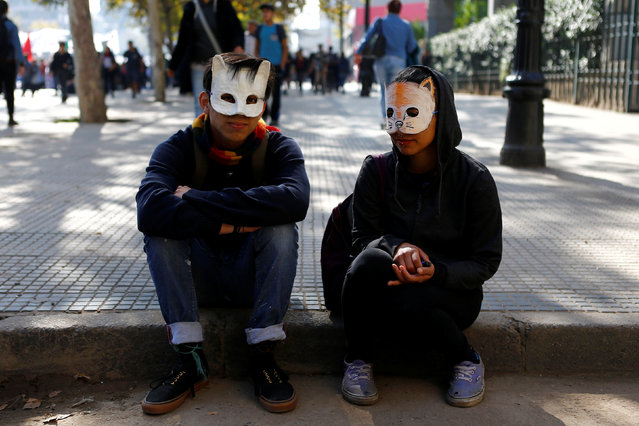 Student protesters attend a demonstration to demand changes in the education system in Santiago, Chile, April 21, 2016. (Photo by Ivan Alvarado/Reuters)