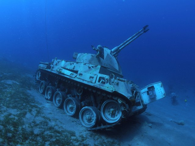 This handout picture released by Jordan's Aqaba Special Economic Zone Authority (ASEZA) on July 23, 2019 shows a Jordanian Armed Forces armored vehicle lies on the seabed of the Red Sea off the coast of the southern port city of Aqaba, part of a new underwater military museum. (Photo by Aqaba Special Economic Zone Authority via Reuters)