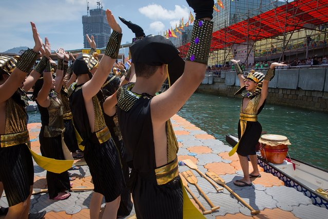 Dragon boat racers perform a dance for watching spectators before the fancy dress race on July 5, 2015 in Hong Kong, Hong Kong. (Photo by Taylor Weidman/Getty Images for Hong Kong Images)