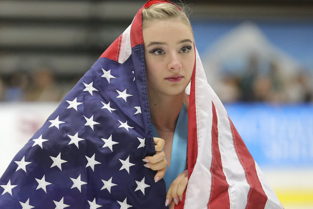 Flag-draped Amber Glenn, of the United States, skates around the rink after her third-place finish at the U.S. International Figure Skating Classic on Saturday, September 21, 2019, in Salt Lake City. (Photo by Rick Bowmer/AP Photo)
