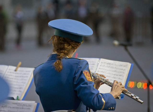 A military band performs during Victory Day celebrations in Odessa, Ukraine, Friday, May 9, 2014. (Photo by Vadim Ghirda/AP Photo)