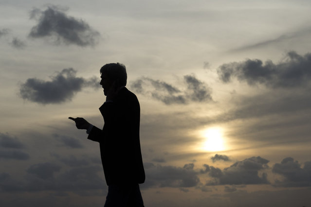 US Secretary of State John Kerry talks on his cellphone, during an airplane refueling stop at Sal Island, Cape Verde, enroute to Washington, DC, Monday, May 5, 2014. (Photo by Saul Loeb/AP Photo)